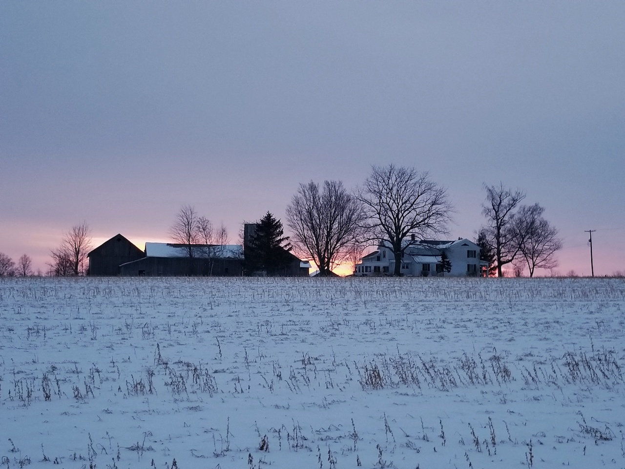 Old barn outside Gorham in mid-winter (photo)